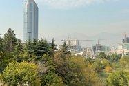 نمونه عکس دوربین تله فوتو آیفون ۱۲ پرو اپل در طول روز - منظره ساختمان های خیابان جردن تهران