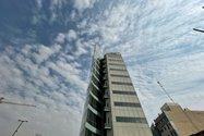 نمونه عکس دوربین اولتراواید آیفون ۱۲ پرو اپل در طول روز - ساختمان کارگزاری مفید تهران