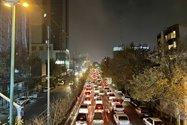 نمونهعکس دوربین اصلی آیفون ۱۲ پرو مکس در تاریکی - ترافیک بزرگراه حقانی