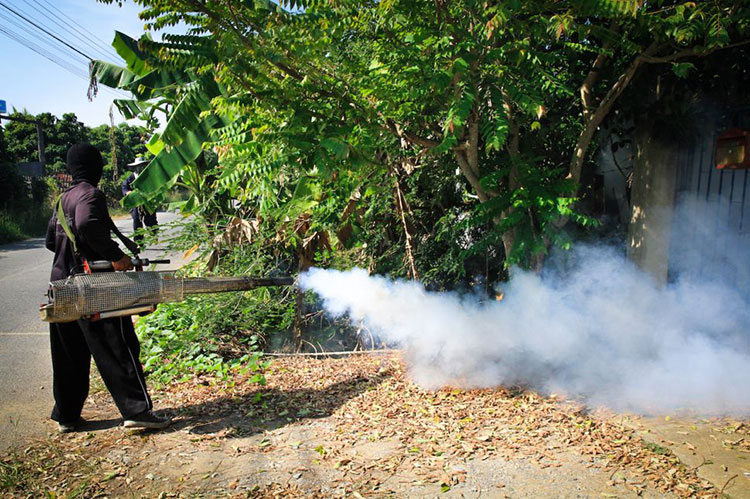 A worker sprays pesticide to kill mosquitoes that carry the Zika virus