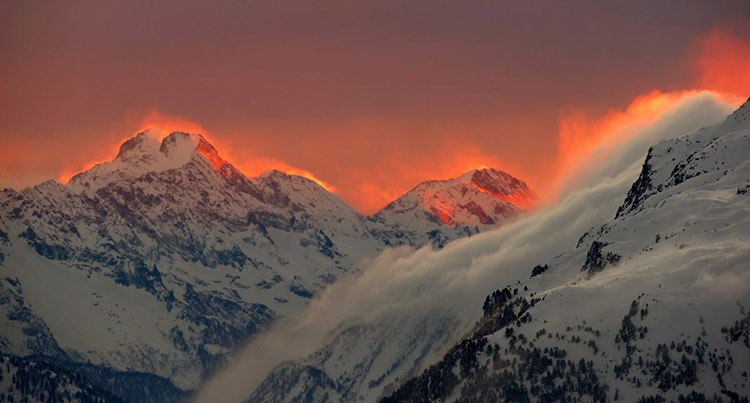 17 the sunset illuminates the peaks of the mountains near the swiss mountain resort of st moritz s bfa76