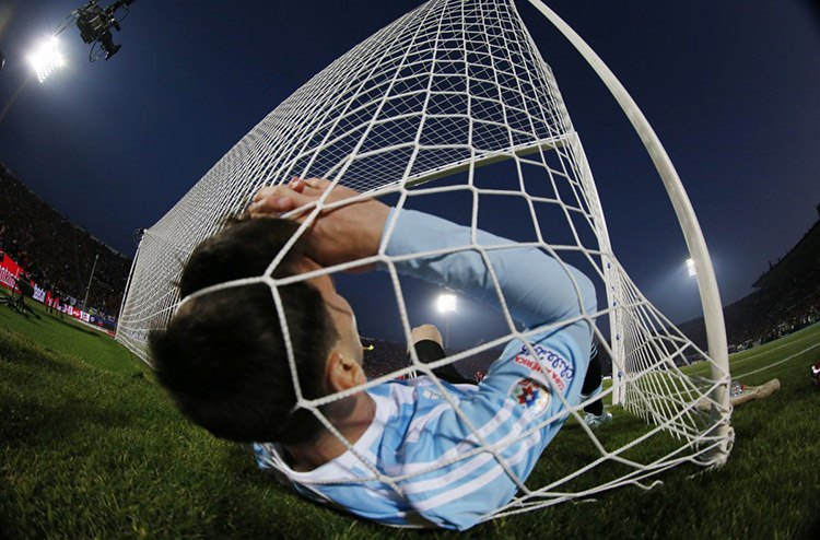 6 argentinas lionel messi falls in the net during the copa america 2015 final soccer match against chile at the national stadium in santiago chile s fd8bf